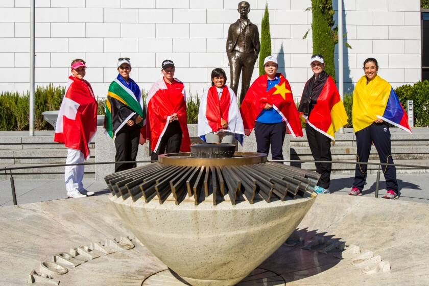 Fabienne In Albon, Paula Reto, Alena Sharp, Julietta Granada, Shanshan Feng, Caroline Masson and Mariajo Uribe in front of the Olympic Flame at the Olympic Museum