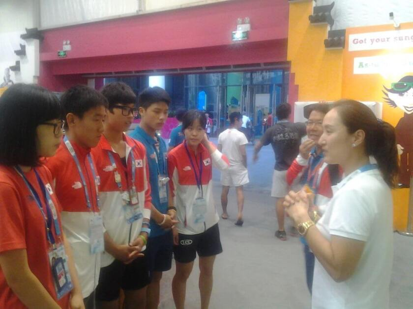 Grace Park, Golf's Athlete Role Model for the Nanjing 2014 Olympic Games, in discussion with golf athletes at the Youth Olympic Village
